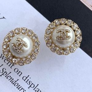 Authentic chanel crystal button  earrings